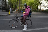 In this April 20, 2020 file photo, a delivery man wearing protective gear checks his phones during a nationwide lockdown in Paris. France is rolling out its contact-tracing app aimed to help contain the spread of the coronavirus as life slowly returns to normal while most of its neighbors, including the UK, Germany, and Italy, are also about to launch their own technology. (AP Photo/Francois Mori)