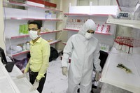 In this May 12, 2020 photo, Yemeni medical workers wearing masks and protective gear stand at the entrance of a hospital in Aden, Yemen. (AP Photo/Wail al-Qubaty)