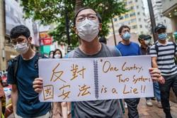 国家安全法制に反対する香港のデモの参加者(Bloomberg)