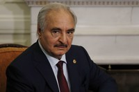 In this Jan. 17, 2020 file, photo, Libyan Gen. Khalifa Hifter joins a meeting with the Greek Foreign Minister Nikos Dendias in Athens. (AP Photo/Thanassis Stavrakis)