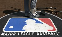 In this April 24, 2013 file photo, Cleveland Indians second baseman Jason Kipnis stands on the Major League Baseball logo that serves as the on deck circle during the first inning of a baseball game between the Chicago White Sox and the Indians, in Chicago. (AP Photo/Charles Rex Arbogast)