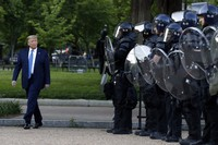 U.S. President Donald Trump walks past police in Lafayette Park after he visited the grounds of St. John's Church, located across from the White House, on June 1, 2020, in Washington. (AP Photo/Patrick Semansky)