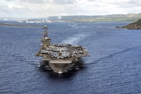 In this June 4, 2020, photo provided by the U.S. Navy, the aircraft carrier USS Theodore Roosevelt (CVN 71) departs Apra Harbor in Guam. (Mass Communication Specialist Seaman Kaylianna Genier/U.S. Navy via AP)