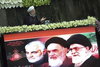 Iranian President Hassan Rouhani speaks during the inauguration of the new parliament, as a screen shows portraits of the Supreme Leader Ayatollah Ali Khamenei, right, late revolutionary founder Ayatollah Khomeini, center, and Gen. Qassem Soleimani, who was killed in Iraq in a U.S. drone attack in early January, in Tehran, Iran, on May, 27, 2020. (AP Photo/Vahid Salemi)