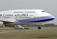 In this Jan. 26, 2003 file photo, a China Airlines Boeing 747-400 is seen on the tarmac at the Chiang Kai-shek International airport in Taoyuan, Taiwan. (AP Photo/Jerome Favre)