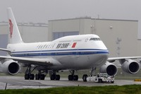 In this Sept. 29, 2014 file photo, the first Boeing 747-8 Intercontinental airplane to be delivered to Air China is moved into position from Boeing's assembly facility to Paine Field in Everett, Washington. (AP Photo/Ted S. Warren)