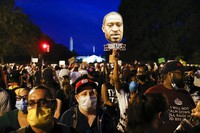 Demonstrators protest Saturday, June 6, 2020, near the White House in Washington, over the death of George Floyd, a black man who was in police custody in Minneapolis. (AP Photo/Jacquelyn Martin)