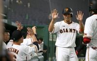 Hiroyuki Nakajima, second from right, gives an