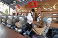 Employees at Universal Studios Japan in Osaka's Konohana Ward in western Japan show the press how they spray roller coaster seats among other preventative measures against the novel coronavirus, on June 4, 2020. (Mainichi/Yoshiyuki Hirakawa)
