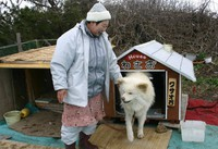Popular Akita dog Wasao and his owner Setsuko Kikuya are seen with a new doghouse that Kikuya made, in the town of Ajigasawa, Aomori Prefecture, on March 24, 2009. (Mainichi)