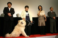Akita dog Wasao and his owner Setsuko Kikuya, second from left, are seen at a press conference for the release of the movie