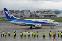 ANA group employees see off a Boeing 737-500, affectionately known as