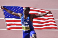 In this Sept. 28, 2019 file photo, Christian Coleman, of the United States, poses after winning the men's 100-meter race during the World Athletics Championships in Doha, Qatar. (AP Photo/Martin Meissner)
