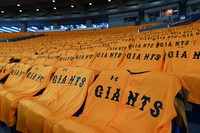 Yomiuri Giants uniforms are seen arranged on the seats in the Tokyo Dome on June 19, 2020, Nippon Professional Baseball (NPB)'s 2020 season opening day, ahead of a game between the Yomiuri Giants and the Hanshin Tigers. NPB is beginning its season some three months late and without fans in the seats due to the novel coronavirus pandemic. (Mainichi/Takehiko Onishi)