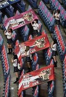 Cheerleaders are seen in the stands with flags bearing players' names and photos plus messages from fans attached to the seats at Kyocera Dome Osaka in western Japan on June 19, 2020, Nippon Professional Baseball (NPB)'s 2020 season opening day, for a game between the Orix Buffaloes and the Tohoku Rakuten Golden Eagles. NPB is beginning its season some three months late and without fans in the seats due to the novel coronavirus pandemic. (Mainichi/Kenji Ikai)