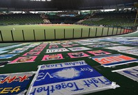 Sheet-sized message from fans are seen arranged on the outfield grass stands at MetLife Dome in Saitama, north of Tokyo, on June 19, 2020, for the Nippon Professional Baseball (NPB) opening day game between the Saitama Seibu Lions and the Hokkaido Nippon-Ham Fighters. NPB is beginning its season some three months late and without fans in the seats due to the novel coronavirus pandemic. (Mainichi/Toshiki Miyama)