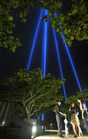 Lights are seen shining toward the sky in hopes for peace in the city of Itoman, Okinawa Prefecture, on June 22, 2020. (Mainichi/Noriko Tokuno)