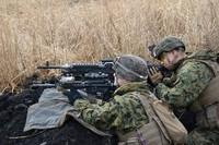 In this February 2020 file photo, U.S. Marines hold small arms live ammunition training at the Hijudai training area in Oita Prefecture. (Mainichi/Tomohiro Tsujimoto)
