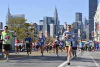 In this Nov. 6, 2011, file photo, runners make their way down 44th Drive in the Queens borough of New York during the New York City Marathon. (AP Photo/Kathy Kmonicek)
