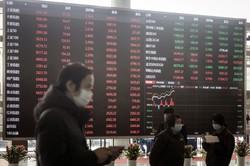 中国の株式や債券の売買に、海外機関投資家が参加しやすくなった(Bloomberg)