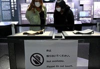 A tile, left, which was damaged in the August 1945 U.S. atomic bombing of Hiroshima, is seen at the Hiroshima Peace Memorial Museum in the city's Naka Ward on June 5, 2020. Visitors are normally allowed to touch the tile, but coronavirus infection countermeasures mean that is no longer the case. (Mainichi/Naohiro Yamada)