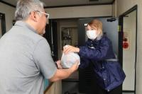 Ekaterina Tetereva is seen making a delivery of restaurant food to a customer in Naniwa Ward, Osaka, on June 12, 2020. (Mainichi/Takao Kitamura)