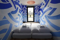 One of the rooms at the hotel in YOLO Base, which have had their interiors designed by 100 artists, is seen in Naniwa Ward, Osaka, on June 12, 2020. (Mainichi/Takao Kitamura)