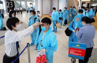 Passengers wearing protective gear are seen boarding a special flight to Vietnam at Narita International Airport in Narita, Chiba Prefecture, on June 25, 2020. (Mainichi/Naoaki Hasegawa)
