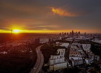 The sun rises over Frankfurt, Germany, with the buildings of the banking district at right, early on July 2, 2020. (AP Photo/Michael Probst)