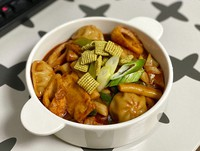 In this July 3, 2020, photo, provided by Lee Hyun Su, pieces of new green onion flavored Chex cereal are sprinkled on a bowl of Tteok-bokki, or stir-fried rice cakes, a popular Korean dish in Seoul, South Korea. The cereal has become a sensation in South Korea after 16 years of delay in its release. (Lee Hyun Su via AP)
