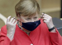 German Chancellor Angela Merkel adjusts her face mask as she arrives for a meeting of the upper house of the German legislative in Berlin, Germany, on July 3, 2020. (AP Photo/Michael Sohn)