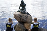 Police stand by the statue of the Little Mermaid, after it was vandalized, in Copenhagen, Denmark, on July 3, 2020. The famed statue of Hans Christian Andersen's Little Mermaid, one of Copenhagen's biggest tourist draws, has been vandalized again. (Mads Claus Rasmussen/ Ritzau Scanpix via AP)