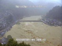 This photo provided by the Ministry of Land, Infrastructure, Transport and Tourism shows the Kuma River, which overflowed following record rainfall, in the village of Kuma in the southwestern Japan prefecture of Kumamoto, on July 4, 2020.