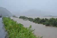 The Kuma River, which overflowed following record rainfall, is seen in the city of Yatsushiro in the southwestern Japan prefecture of Kumamoto at 8:48 a.m. on July 4, 2020. (Mainichi/Yuki Kurisu)