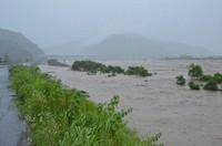 The Kuma River, which overflowed following record rainfall, is seen in the city of Yatsushiro in the southwestern Japan prefecture of Kumamoto at 8:49 a.m. on July 4, 2020. (Mainichi/Yuki Kurisu)
