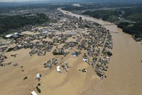 Floodwaters cover a residential area of the city of Hitoyoshi in the southwestern Japan prefecture of Kumamoto after torrential rain caused the Kuma River to overflow, in this photo taken at 11:49 a.m. on July 4, 2020. (Mainichi/Kimiya Tanabe)