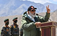 In this handout photo provided by the Press Information Bureau, Indian Prime Minister Narendra Modi addresses soldiers during a visit to Nimu, Ladakh area, India, on July 3, 2020. (Press Information Bureau via AP)