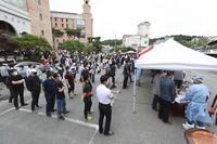 People wait in line for the new coronavirus tests at a church in Gwangju, South Korea, on July 3, 2020. (Chung Hoi-sung/Yonhap via AP)
