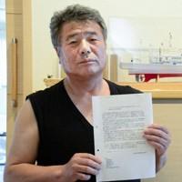 風評被害対策を訴える漁師で浪江町議の高野武さん=福島県浪江町で、渡部直樹撮影
