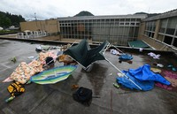 Tents and blankets used by evacuees are seen left on the rooftop of nursing home Senjuen, which was flooded due to torrential rain that hit the southwestern Japan prefecture of Kumamoto, in the prefectural village of Kuma, on July 6, 2020. (Mainichi/Ryoichi Mochizuki)