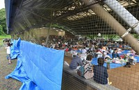 People are seen at an evacuation shelter with no walls, in the village of Kuma, Kumamoto Prefecture, on July 6, 2020. One evacuee told the Mainichi Shimbun that it was distressing to deal with rain coming in at night. (Mainichi/Ryoichi Mochizuki)