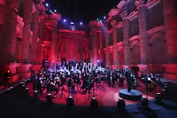 Musicians from the Lebanese Philharmonic Orchestra perform during a concert in the ancient northeastern city of Baalbek, Lebanon, on July 5, 2020. (AP Photo/Bilal Hussein)