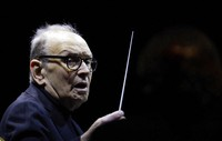 In this file photo dated on March 6, 2018, Italian composer Ennio Morricone directs an ensemble during a concert of his