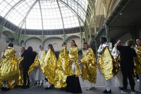 In this Jan. 21, 2020 file photo, models wait before the presentation of Chanel Haute Couture Spring/Summer 2020 fashion collection, in Paris.  (AP Photo/Thibault Camus)