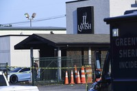 Yellow police tape can be seen outside of the Lavish Lounge in Greenville, S.C., on July 5, 2020, following a deadly shooting. (Ken Ruinard/The Greenville News via AP)