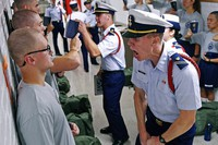 In this July 1, 2019, file photo, Whisky 2 company Cadre Jacob Denns, right, shouts instructions to swab Nicolas Fisher, left, of Pelham, N.H., on the first day of a seven-week indoctrination to military academy life for the Class of 2023 at the U.S. Coast Guard Academy in New London, Conn. (Sean D. Elliot/The Day via AP)