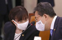 Park Yang-woo, right, minister of the Ministry of Culture, Sports and Tourism, talks with Choi Yoon-hee, left, vice minister of the Ministry of Culture, Sports and Tourism during a parliamentary committee meeting at the National Assembly in Seoul, South Korea, on July 6, 2020. (Kim Sun-woong/Newsis via AP)