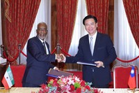In this photo released by the Taiwan Ministry of Foreign Affairs, Taiwan's Foreign Minister Joseph Wu, right, and his counterpart from Somaliland, Yasin Hagi Mohamoud shake hands after signing an agreement for setting up representative offices in their respective territories in Taipei on Feb. 26, 2020. (Taiwan Ministry of Foreign Affairs via AP)