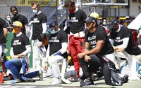 Drivers take a knee in support of the Black Lives Matter movement before the Austrian Formula One Grand Prix race at the Red Bull Ring racetrack in Spielberg, Austria, on July 5, 2020. (Dan Istitene/Pool via AP)