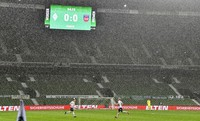 The board shows the result in heavy rain during the German Bundesliga relegation first leg soccer match between Werder Bremen and 1. FC Heidenheim in Bremen, Germany, on July 2, 2020. Because of the coronavirus outbreak all soccer matches of the German Bundesliga take place without spectators. (AP Photo/Martin Meissner, Pool)